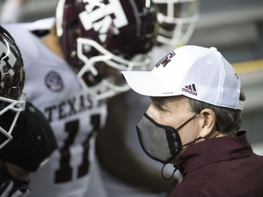 Texas A&M head coach Jimbo Fisher prepares to take the field with players before an NCAA college football game against South Carolina Saturday, Nov. 7, 2020, in Columbia, S.C. Texas A&M won 48-3. (AP Photo/Sean Rayford)