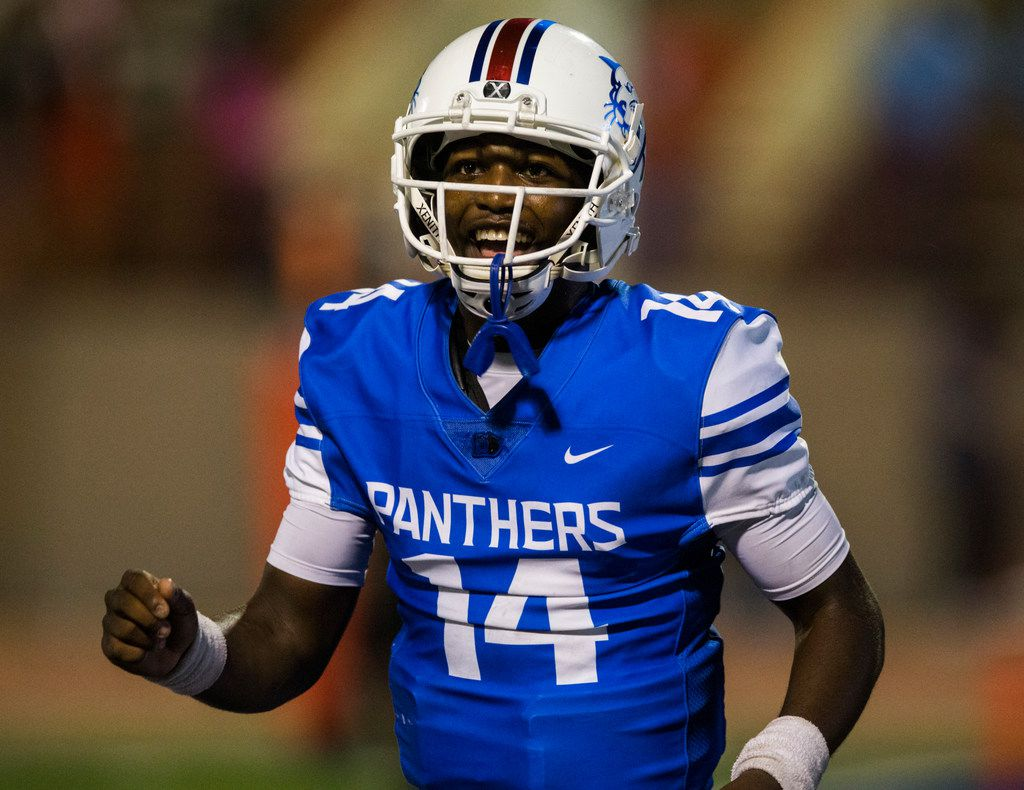 Duncanville quarterback Chris Parson (14) smiles after scoring a touchdown during the fourth quarter of a high school football game between Skyline and Duncanville on Friday, October 4, 2019 at Panther Stadium in Duncanville. (Ashley Landis/The Dallas Morning News)