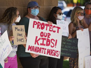 Supporters of mask mandates lined up before Monday's Carroll ISD school board meeting in Southlake.