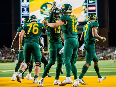 Baylor Bears quarterback Charlie Brewer (12) celebrates a touchdown with wide receiver R.J. Sneed (13) during the second quarter of an NCAA football game between Baylor University and Oklahoma University on Saturday, November 16, 2019 at McLane Stadium in Waco, Texas.