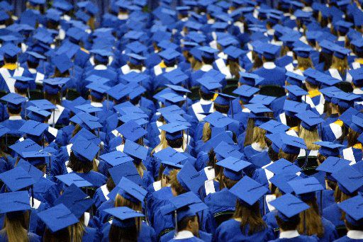 Students are pictured at a Plano West Senior High School graduation ceremony. The Plano ISD is currently weighing whether to postpone graduation ceremonies to later in the summer or hold them virtually.