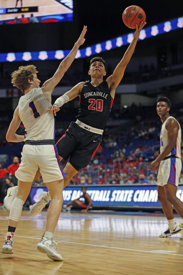 Duncanville Juan Reyna #20 shoots over Westlake Cade Mankle #1. UIL boys Class 6A basketball state championship game between Duncanville and Austin Westlake on Saturday, March 13, 2021 at the Alamodome.