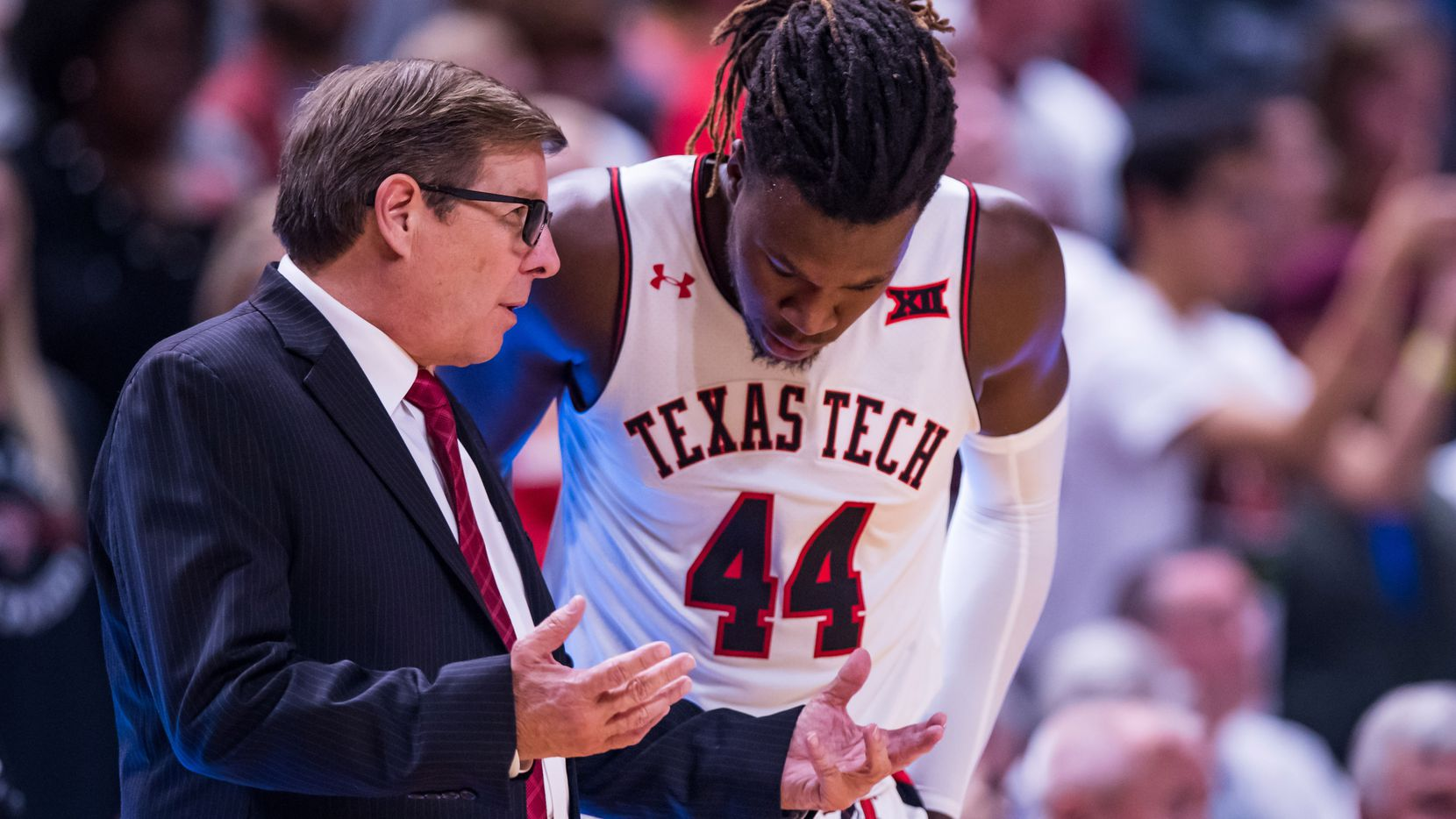 Associate head coach Mark Adams and forward Chris Clarke #44 of the Texas Tech Red Raiders talk on the sideline during the second half of the college basketball game against the Tennessee State Tigers on November 21, 2019 at United Supermarkets Arena in Lubbock, Texas. (Photo by John E. Moore III/Getty Images)