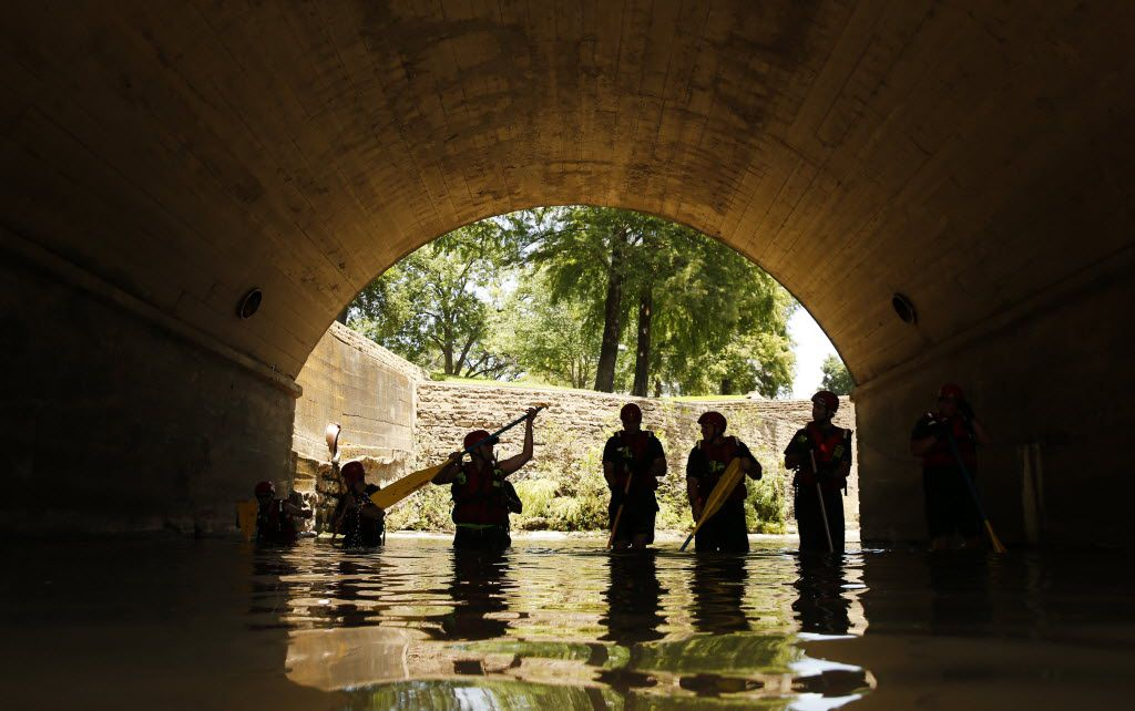 Search One Rescue team resumes their search in the waters under Hall St. on  Turtle Creek in Dallas on Wednesday, July 6, 2016, for the body of an off-duty SMU police officer who disappeared after reporting his car was being overtaken by water during a heavy storm early Tuesday as he was working a security job.
