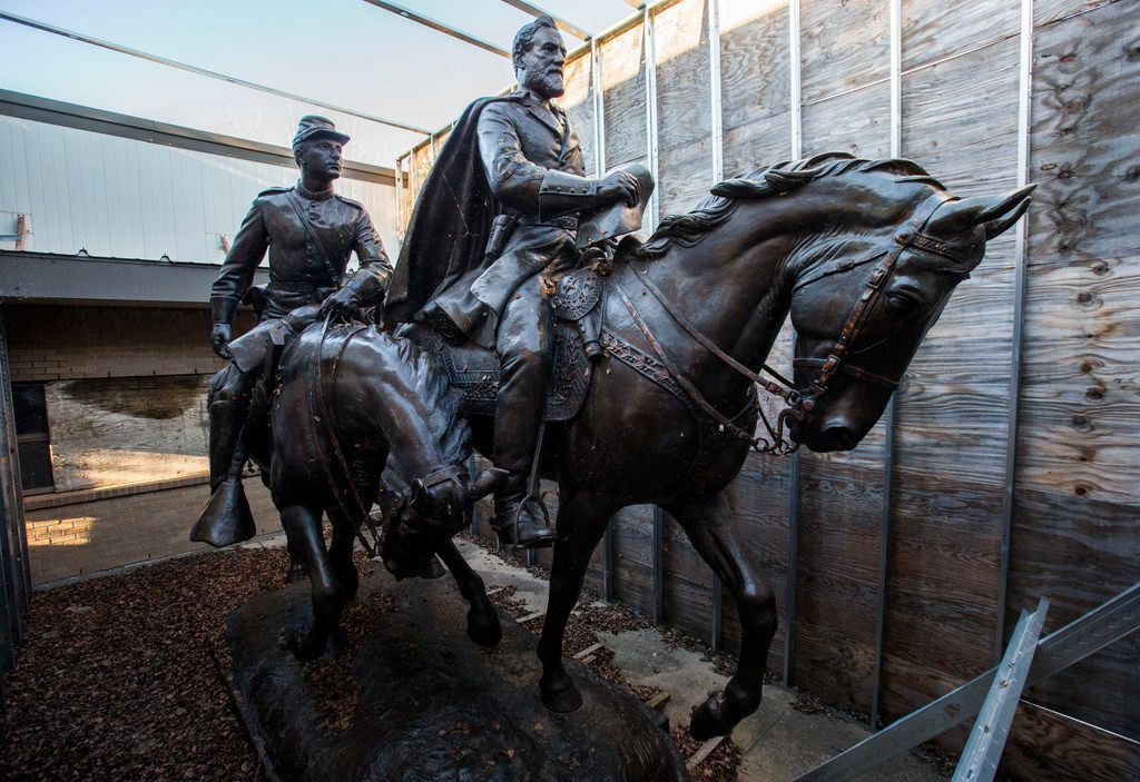 A sculpture of Confederate Gen. Robert E. Lee and a young soldier on horseback was kept at Hensley Field, the former Naval Air Station on the west side of Mountain Creek Lake in Dallas, until it was sold to Addison-based attorney Ronald Holmes. The statue is now housed at Black Jack's Crossing Golf Course in Lajitas, Texas. (Ashley Landis/The Dallas Morning News)