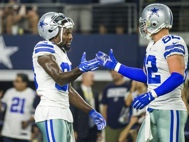 Dallas Cowboys wide receiver Dez Bryant (88) shakes hands with tight end Jason Witten (82) before an NFL football game against the Chicago Bears at AT&T Stadium on Sunday, Sept. 25, 2016, in Arlington.
