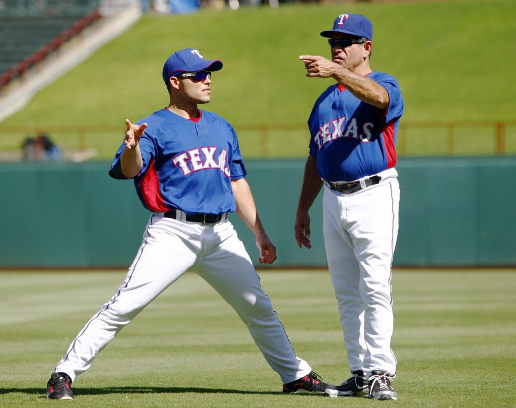 "Texas Rangers catcher Ivan ""Pudge"" Rodriguez (7 - left) talks with Hitting Coach Rudy  Jaramillo (right) during stretching exercises just  prior to batting practice before MLB baseball action between the Minnesota Twins and the Texas Rangers at the Rangers Ballpark in Arlington on Tuesday, August 18, 2009. (John F. Rhodes / The Dallas Morning News )"