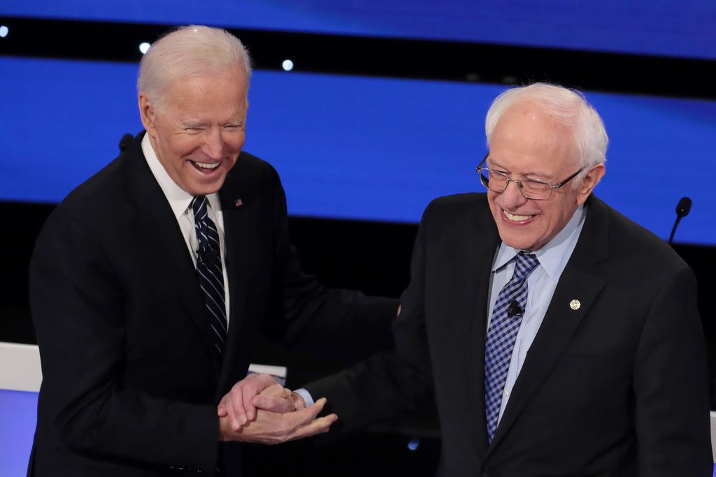 Former Vice President Joe Biden greets Sen. Bernie Sanders before the Democratic presidential primary debate at Drake University on January 14, 2020 in Des Moines, Iowa.