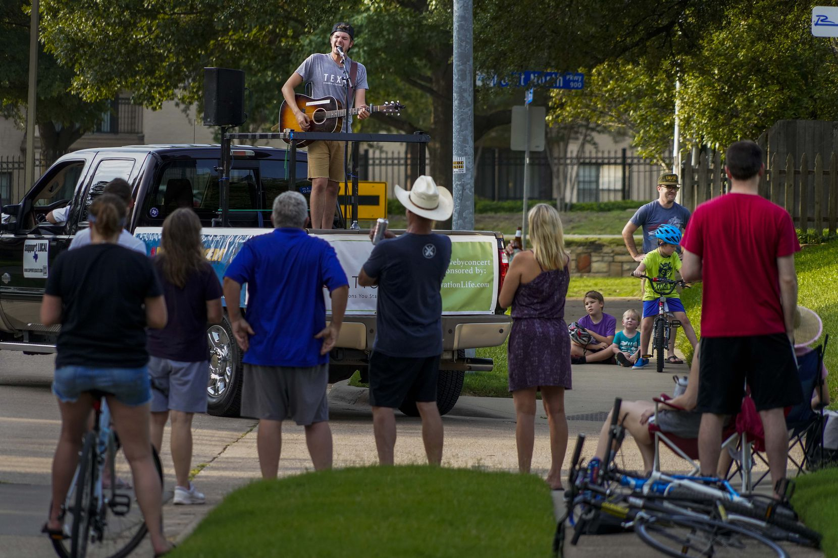 Cameron Havens sings from the back of a pickup truck during a 'Drive By Concert' through the Canyon Creek subdivision on Thursday, July 2, 2020, in Richardson. The concert stopped in front of different houses throughout the neighborhood as part of series of Drive-By Concerts sponsored by Plano Magazine and Ovation Health & Life Services in Plano and surrounding neighborhoods.