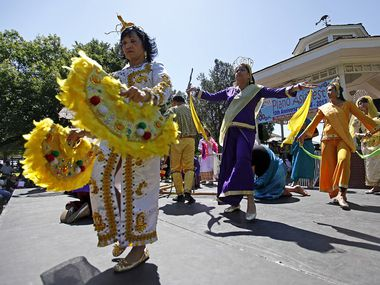 The Maharlika Dancers, U.S.A., perform a traditional Phillipine dance during Plano AsiaFest 2013 at Haggard Park in downtown Plano.