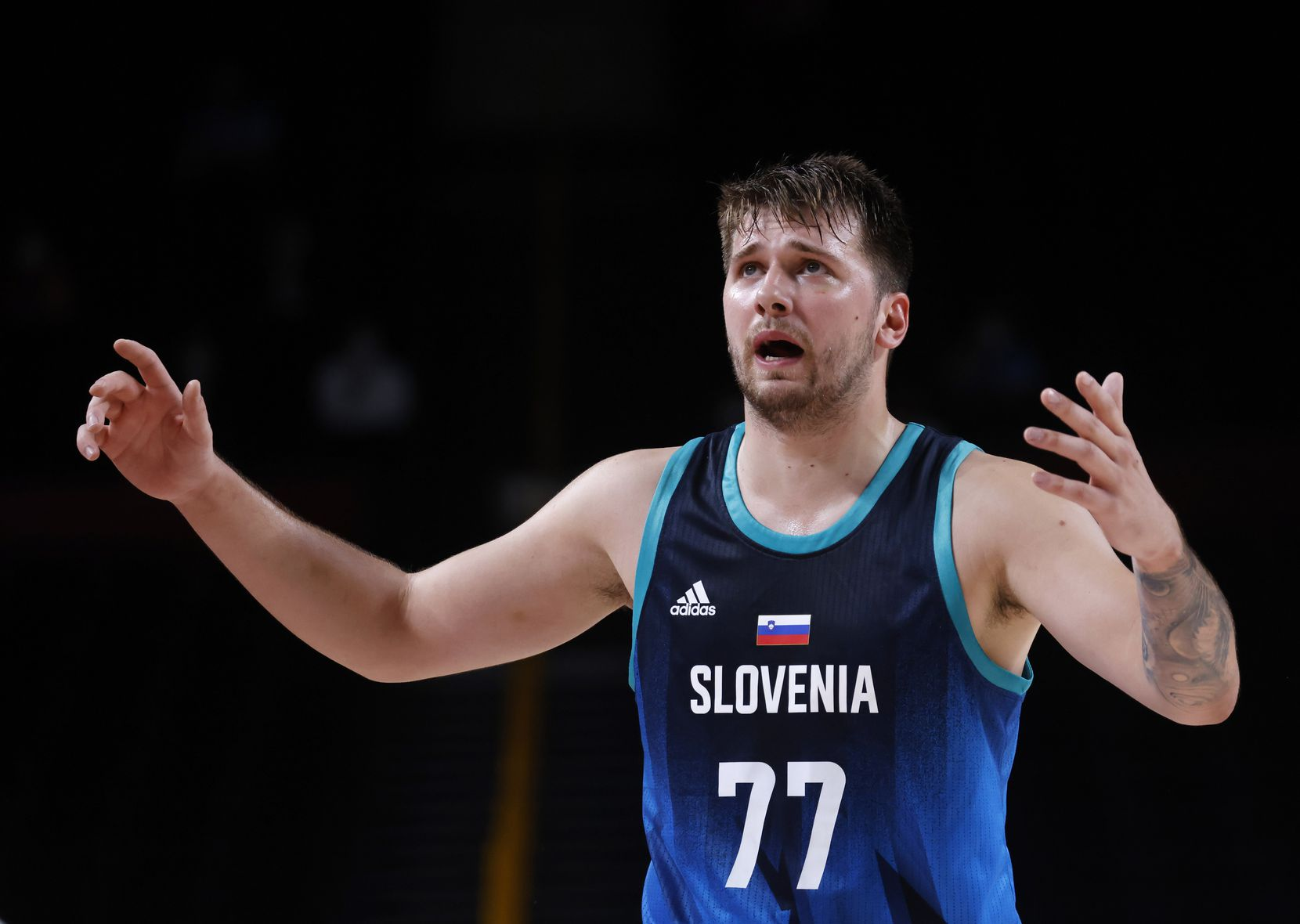 Slovenia's Luka Doncic reacts to not getting a call on the last play in a game against France during the second half of a men's basketball semifinal at the postponed 2020 Tokyo Olympics at Saitama Super Arena, on Thursday, August 5, 2021, in Saitama, Japan. France defeated Slovenia 90-89. Slovenia will play in the bronze medal game. (Vernon Bryant/The Dallas Morning News)