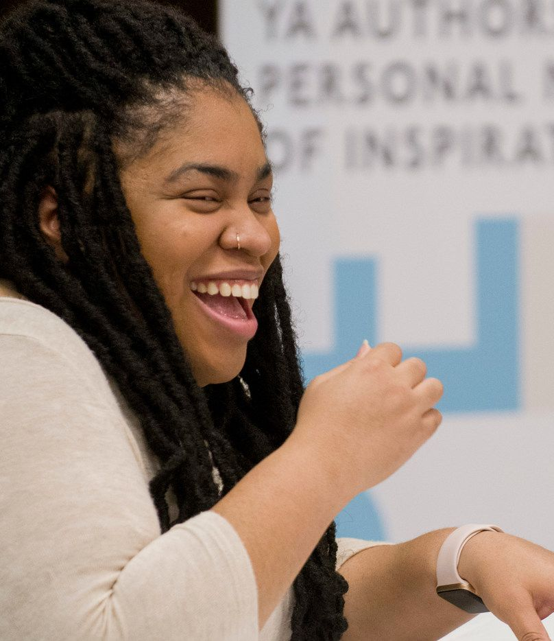 Author Angie Thomas laughs while participating in a panel discussion at the South Irving Library in Irving on Feb. 25, 2018.EDI