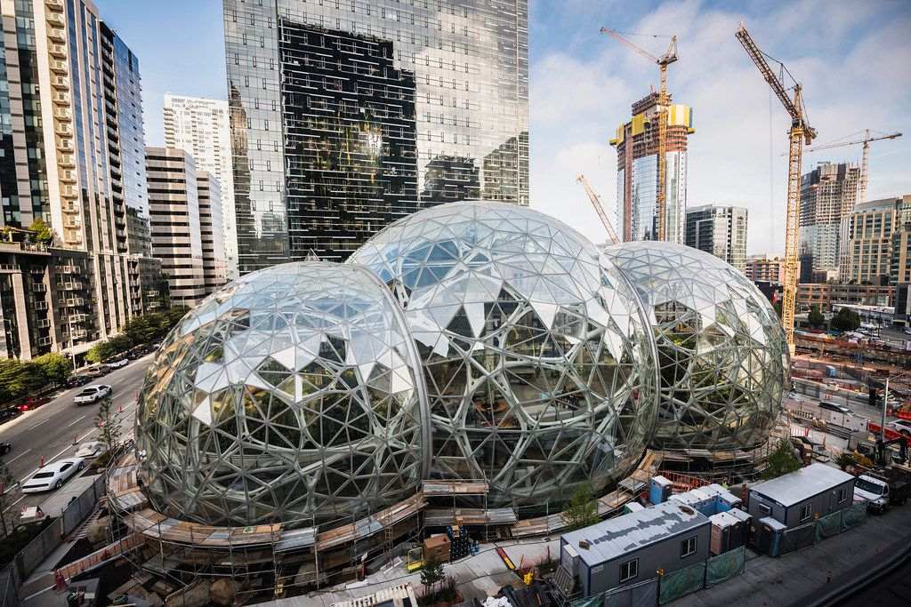 Amazon Tower II rises above the Amazon Biospheres in Seattle. (Christopher Miller/The New York Times)