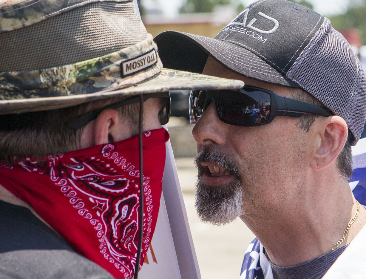 An anti-Shariah protester (right), who refused to provide his name, verbally clashes with an opponent to his position on Saturday, June 10, 2017, at the intersection of Abrams Road and Centennial Boulevard in Richardson, Texas. (Ryan Michalesko/The Dallas Morning News)