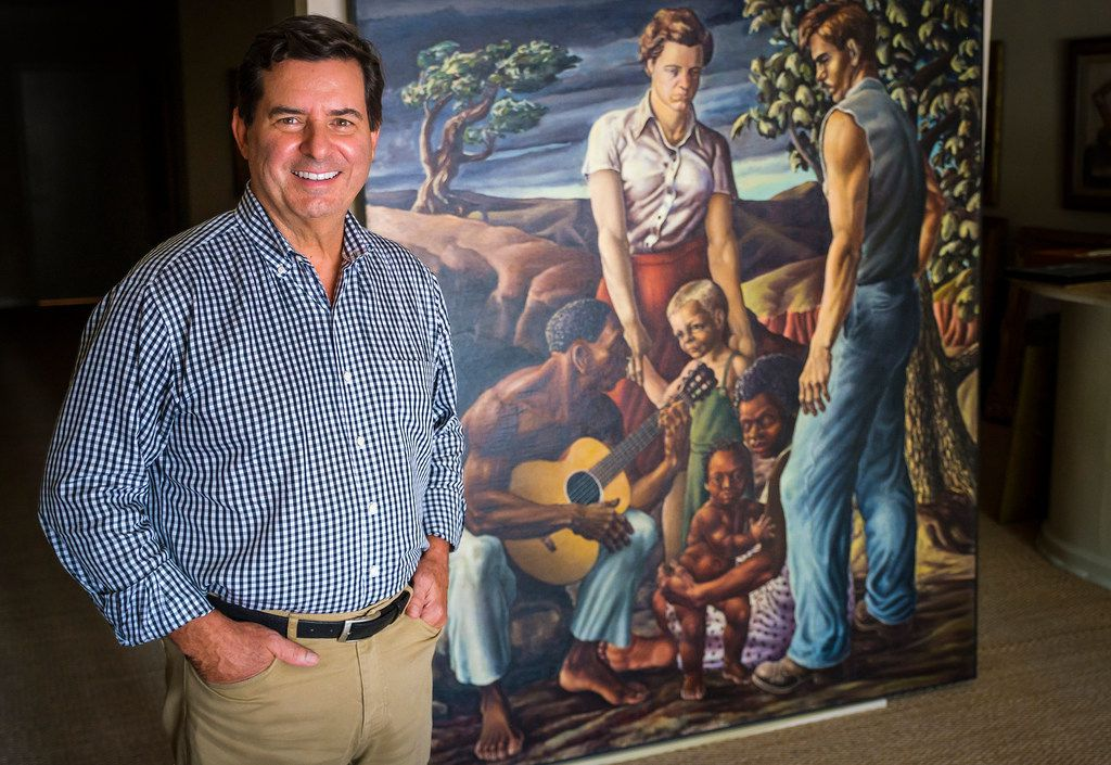 David Dike Fine Art founder and owner David Dike is photographed with a painting by Michael G. Owen, Jr., at the gallery on Thursday, Sept. 12, 2019, in Dallas.  The gallery has recently come into possession of a number of materials by the Depression-era Dallas artist. (Smiley N. Pool/The Dallas Morning News)