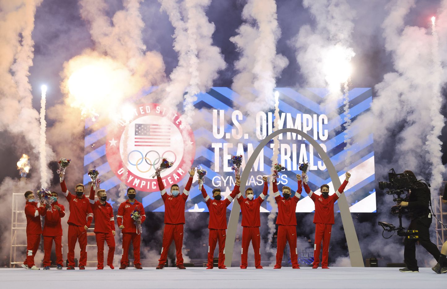 Gymnasts celebrate after the U.S. Olympic team was announced during day 2 of the men's 2021 U.S. Olympic Trials at America's Center on Saturday, June 26, 2021 in St Louis, Missouri.(Vernon Bryant/The Dallas Morning News)
