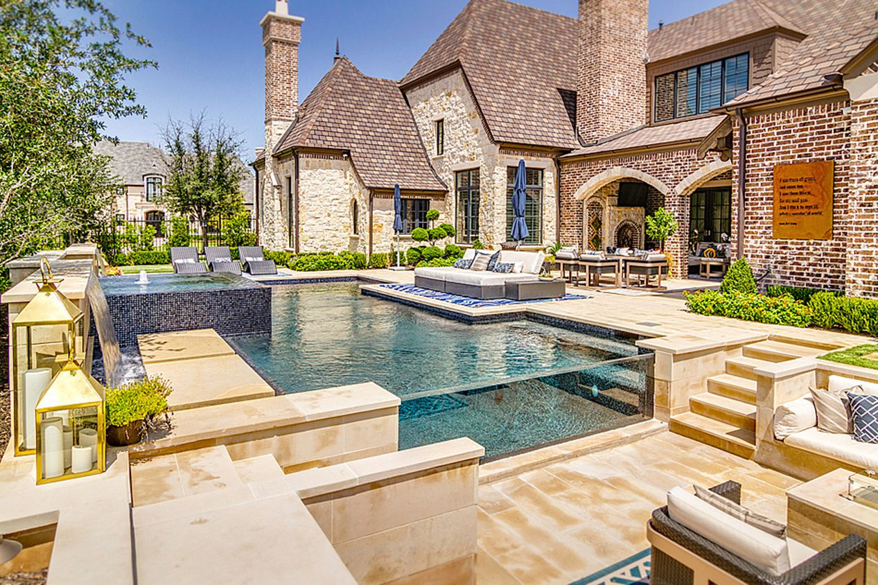 The estate at 6808 Mulhouse Court in Plano offers a pool, spa and covered and open patios.