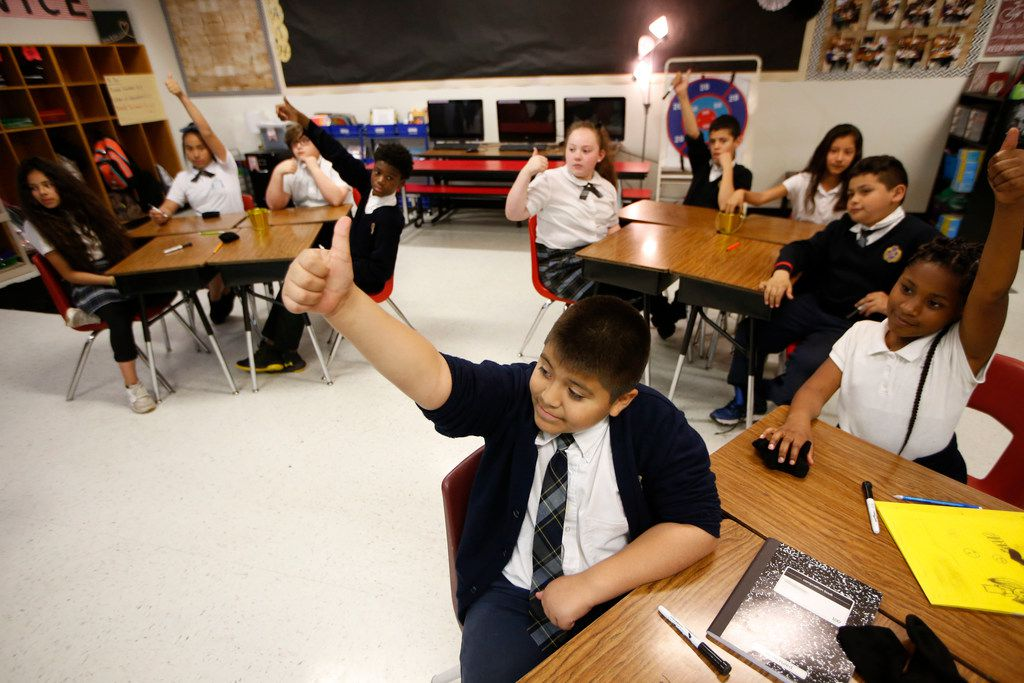 Adrian Torres gives the thumbs-up to a correct answer during his fifth-grade math class at Annie Webb Blanton Elementary in Dallas on May 17, 2018. Blanton Elementary is one of Dallas ISD's ACE schools, where extra money and resources have been poured in to bolster struggling campuses.