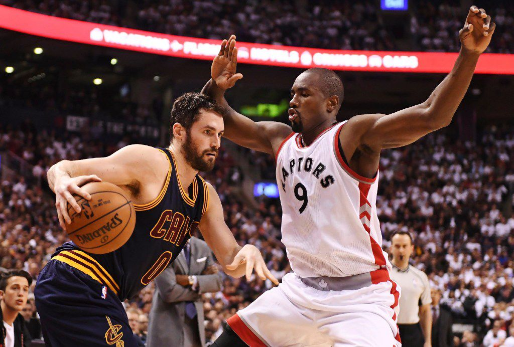 Cleveland Cavaliers forward Kevin Love (0) protects the ball from Toronto Raptors forward Serge Ibaka (9) during the second half of Game 3 of an NBA basketball second-round playoff series in Toronto on Friday, May 5, 2017. (Frank Gunn/The Canadian Press via AP)