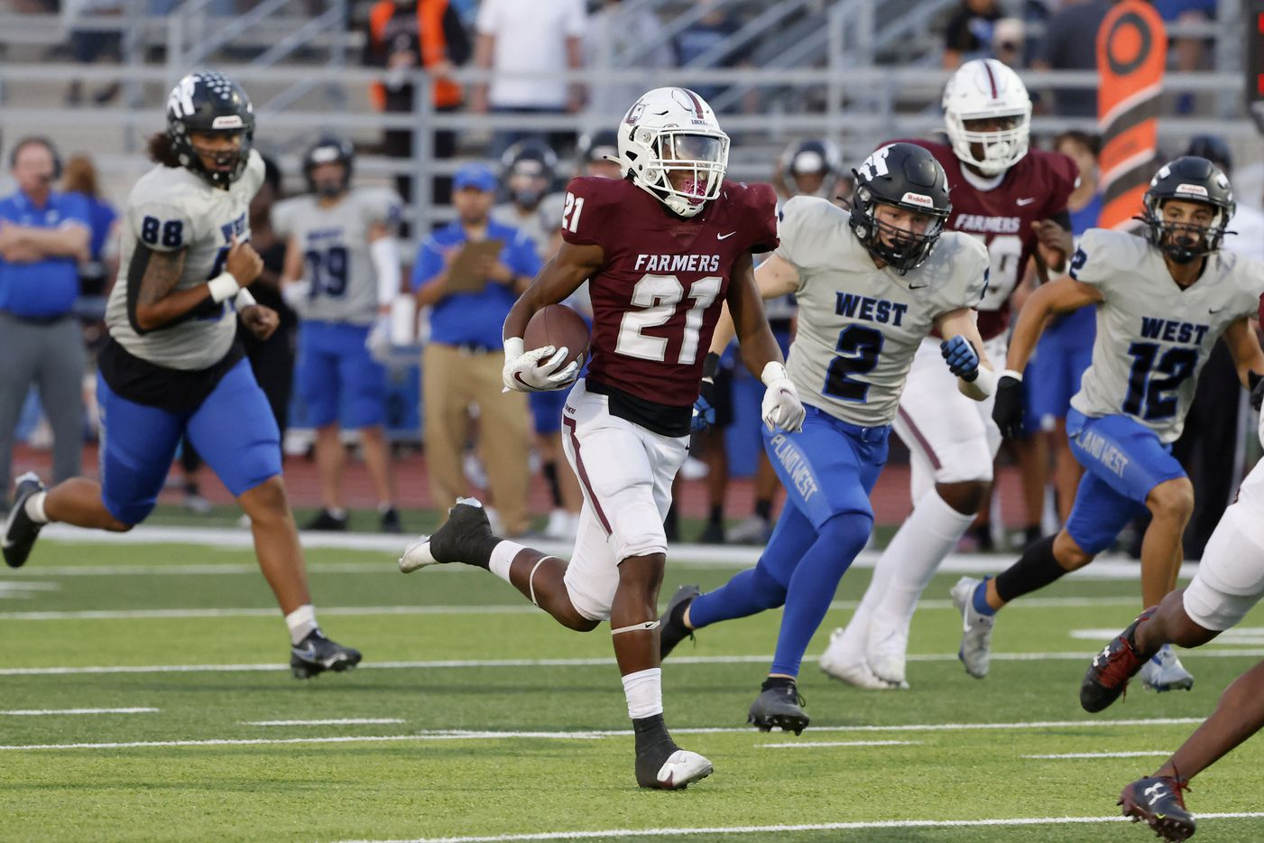 Lewisville running back Viron Ellison is chased by Plano West defender Reese Gunby (2) as he runs for yardage during the first half of a high school football game in Lewisville, Texas on Friday, Sept. 24, 2021. (Michael Ainsworth/Special Contributor)