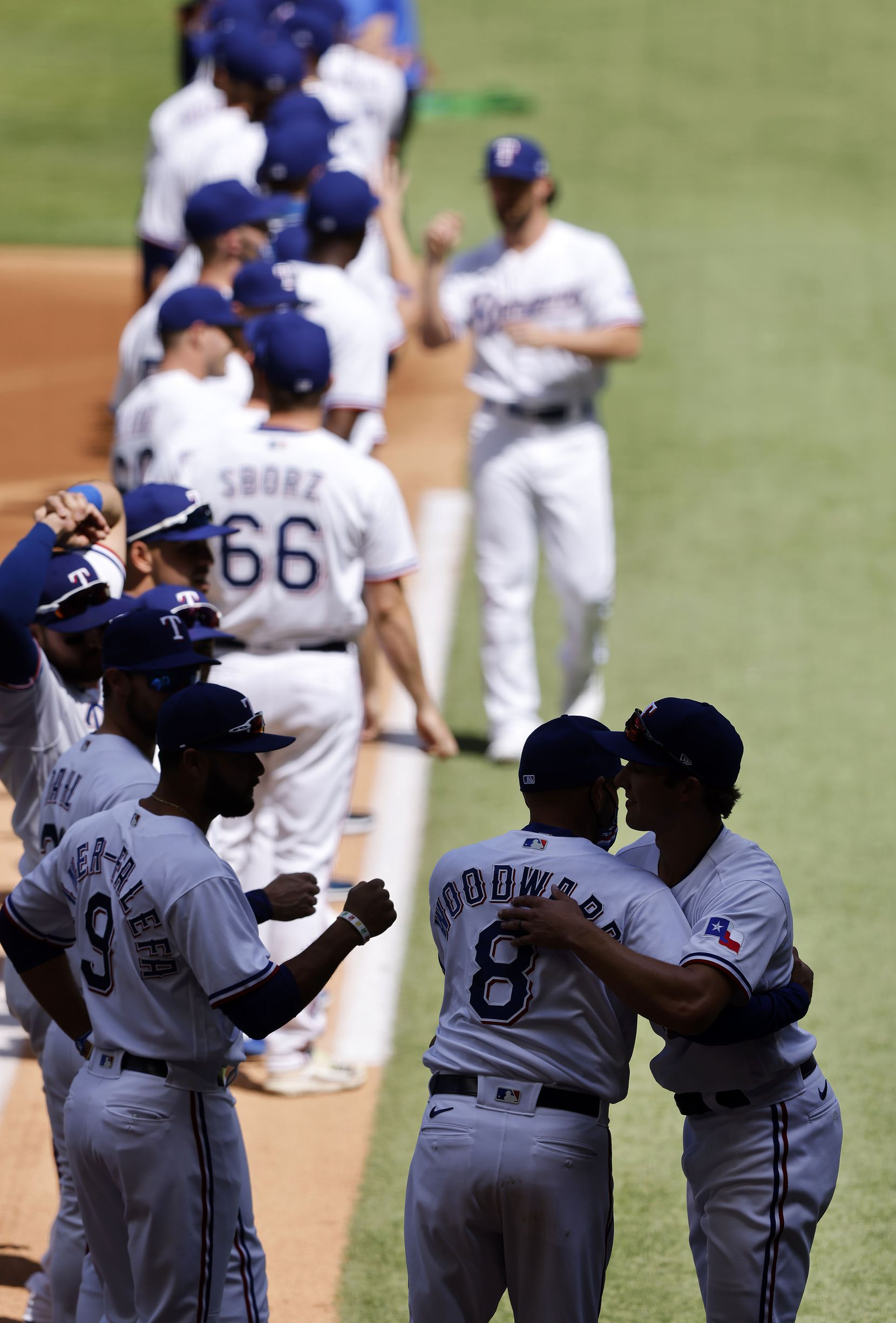 Texas Rangers manager Chris Woodward hugged his players as they're introduced during pregame ceremonies at Globe Life Field in Arlington, Monday, April 5, 2021. The Texas Rangers were facing the Toronto Blue Jays in their home opener. (Tom Fox/The Dallas Morning News)