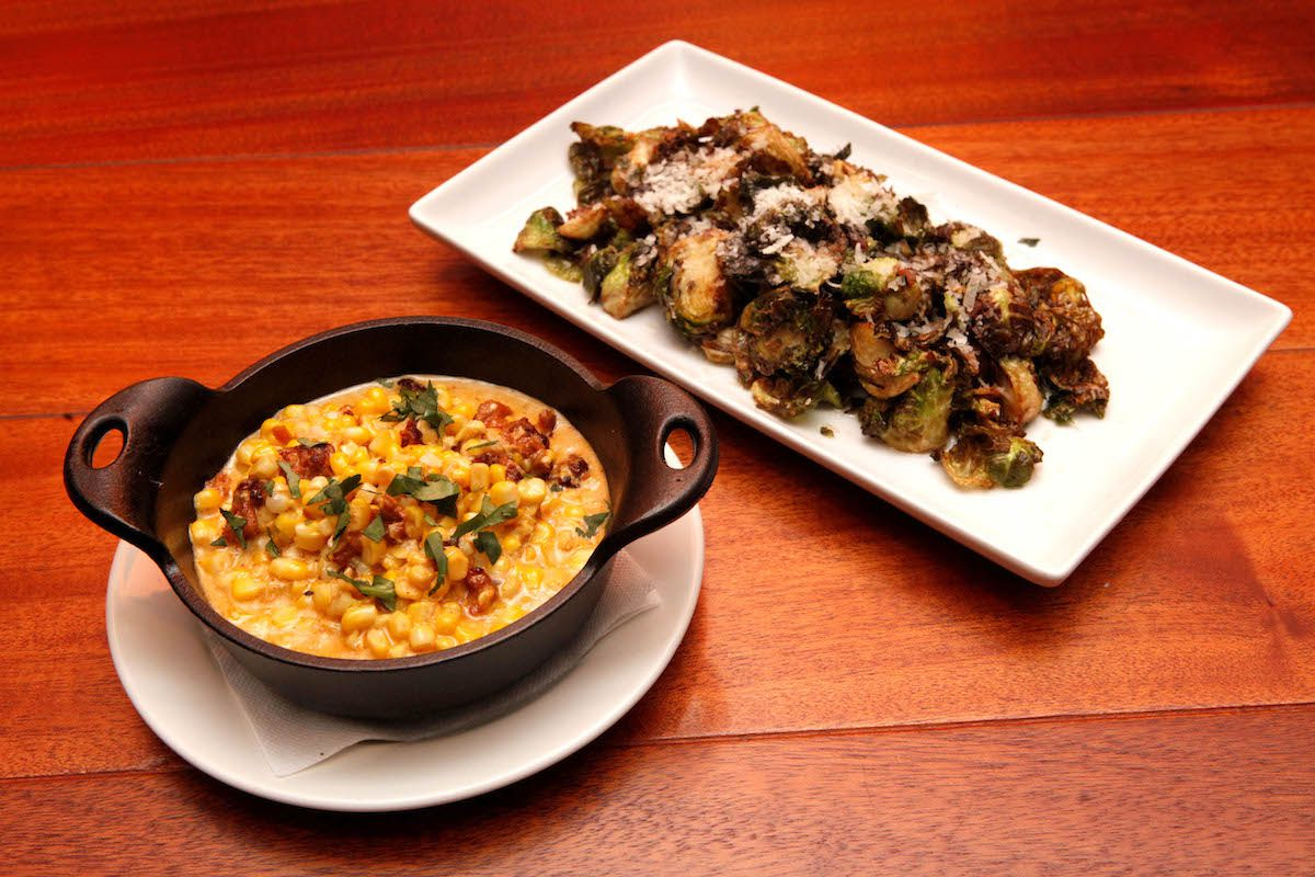 Dee Lincoln Steak Bar's chorizo corn and crispy brussels sprouts are on the Father's Day menu.