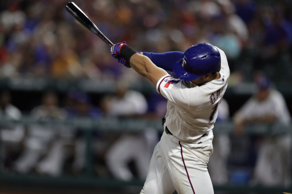 ARLINGTON, TX - JULY 26:  Joey Gallo #13 of the Texas Rangers hits a homerun against the Oakland Athletics in the fifth inning at Globe Life Park in Arlington on July 26, 2016 in Arlington, Texas.  (Photo by Ronald Martinez/Getty Images)