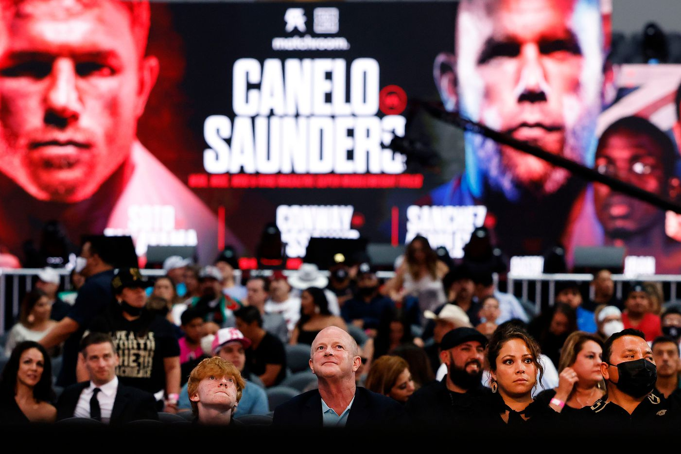 Fans watch the early bouts before the Canelo Alvarez-Billy Joe Saunders fight at AT&T Stadium in Arlington, Saturday, May 8, 2021. (Tom Fox/The Dallas Morning News)