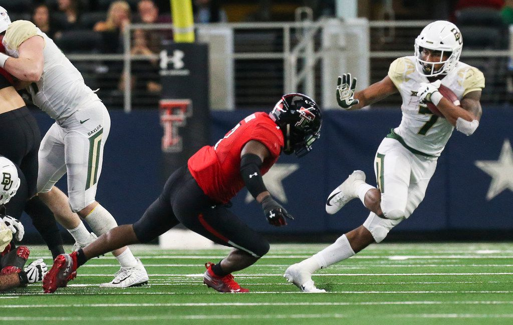 Baylor Bears running back John Lovett (7) makes a run past Texas Tech Red Raiders defensive back Jah'Shawn Johnson (7) during the second half of a matchup between Baylor and Texas Tech on Saturday, Nov. 24, 2018 at AT&T Stadium in Arlington, Texas. (Ryan Michalesko/The Dallas Morning News)