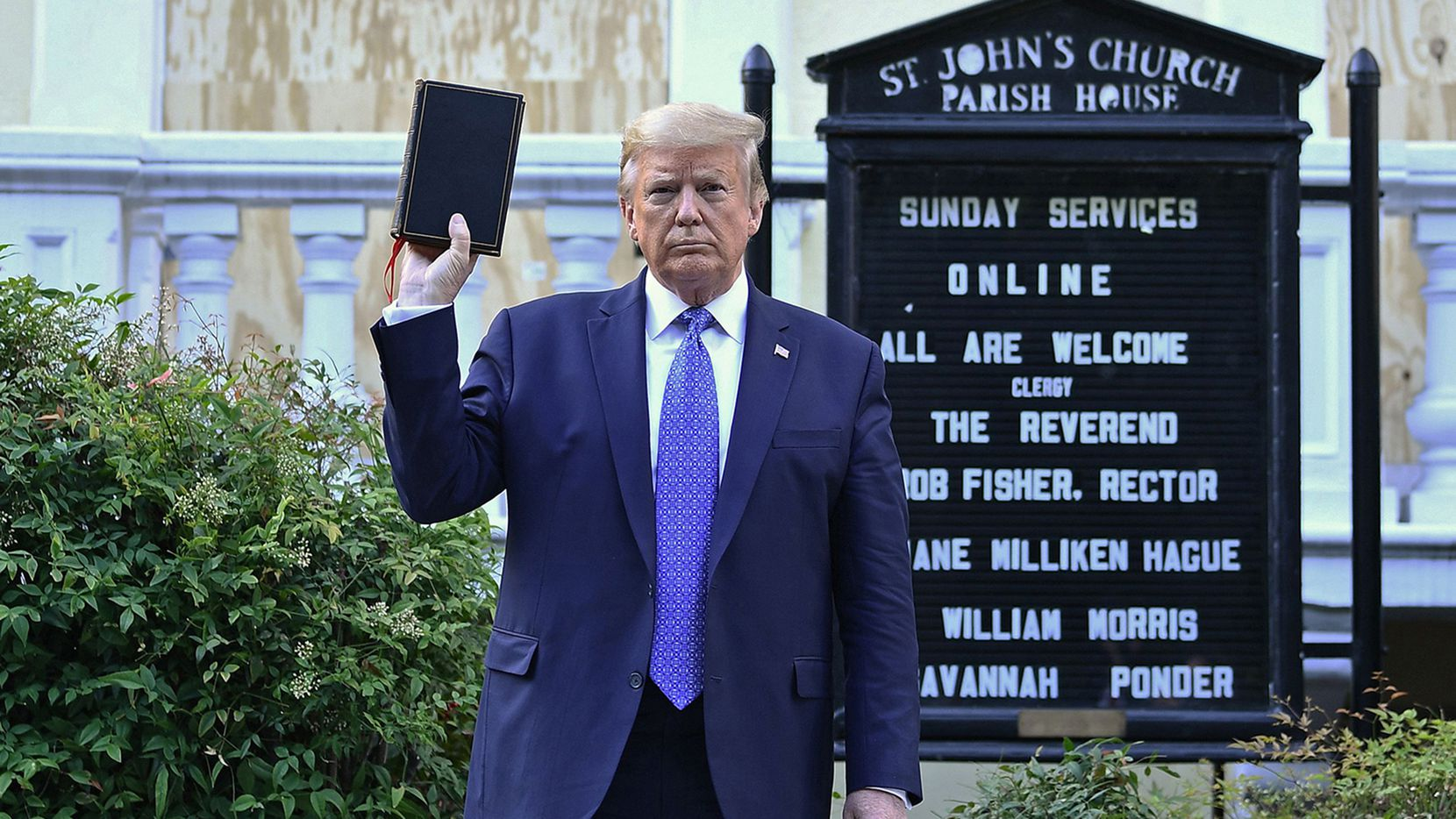 President Donald Trump holds up a Bible outside of St John's Episcopal church across Lafayette Park from the White House on  June 1, 2020.