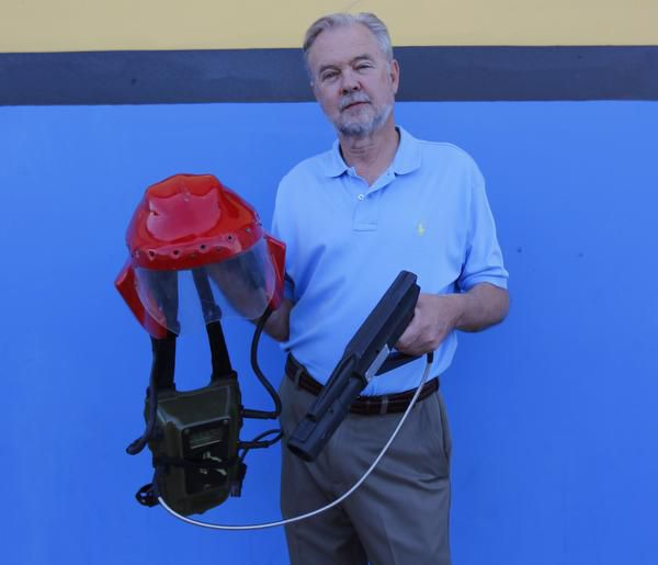 George Carter, who invented laser tag in Dallas in 1984, shows off some of the original gear used in the game. He visited Alley Cats in Arlington recently to check out its laser tag facility.