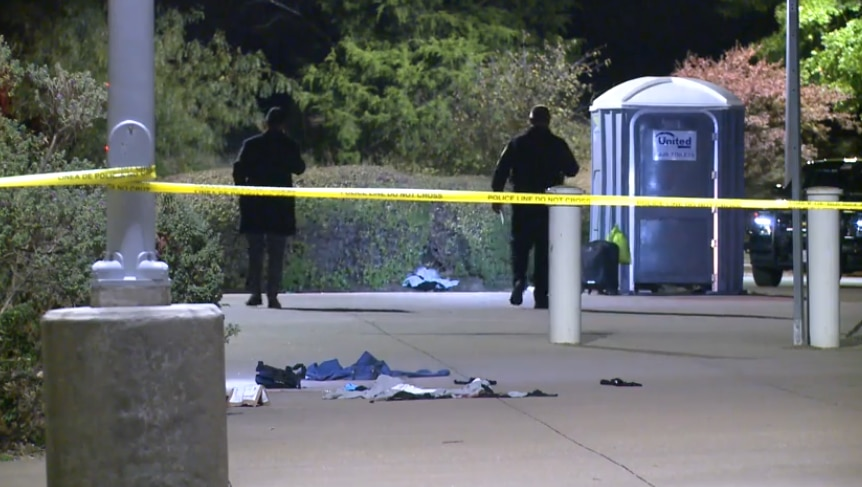 Officers investigate the aftermath of a fatal shooting at TRE's CentrePort/DFW Airport station in Fort Worth in an image taken from footage shot by Metro Video Dallas/Fort Worth.