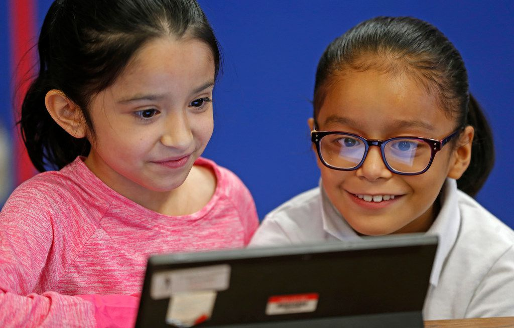 Third graders Mia Pedraza (left) and Jennifer Villagomez work on creating game lesson during a coding class at Frederick Douglass Elementary in Dallas, Thursday, Oct. 12, 2017. Dallas ISD is rapidly expanding computer science instruction to elementary schools across the district, as part of an effort between DISD and Code.org. (Jae S. Lee/The Dallas Morning News)