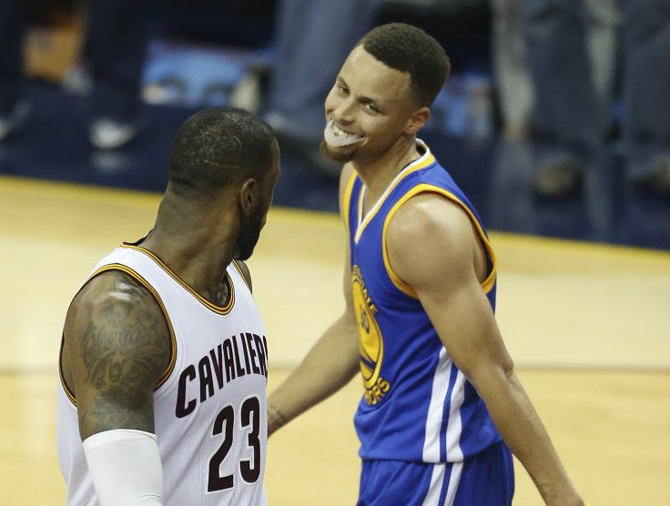 FILE - In this June 16, 2016, file photo, Cleveland Cavaliers forward LeBron James (23) and Golden State Warriors guard Stephen Curry (30) look at each other during the second half of Game 6 of basketball's NBA Finals, in Cleveland. While there have been 14 rematches in NBA Finals history, this year's meeting between LeBron James' Cleveland Cavaliers and Stephen Curry's Golden State Warriors will be the first trilogy in league history. (AP Photo/Ron Schwane, File)