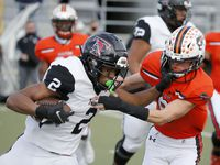 Euless Trinity running back Ollie Gordan (2) is tackled for a loss by Haltom safety Aaron Ellis (6)during their District 3-6 high school football game on Nov. 27, 2020.