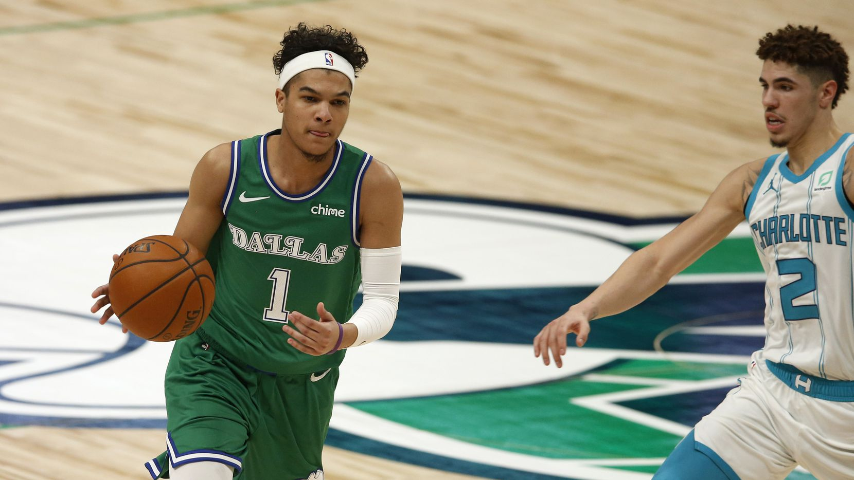 Dallas Mavericks guard Tyrell Terry (1) dribbles around Charlotte Hornets guard LaMelo Ball (2) during the fourth quarter of play in the home opener at American Airlines Center on Wednesday, December 30, 2020 in Dallas. The Mavericks lost to the Hornets 118-99.
