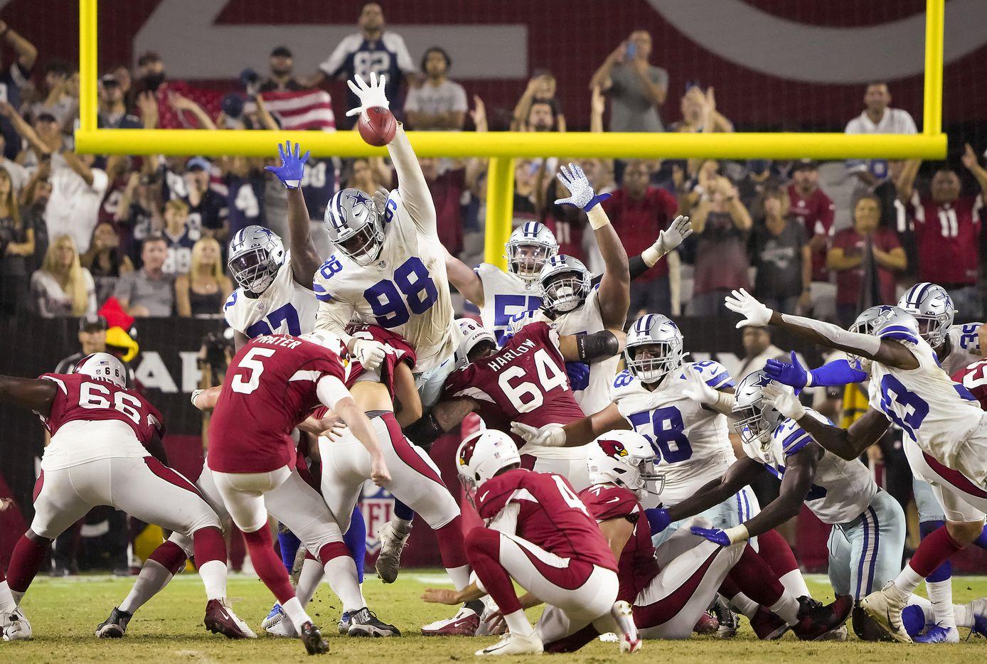 Arizona Cardinals kicker Matt Prater (5) kicks a game-winning 57-yard field goal over Dallas Cowboys defensive tackle Quinton Bohanna (98) on the final play of a preseason NFL football game at State Farm Stadium on Friday, Aug. 13, 2021, in Glendale, Ariz.