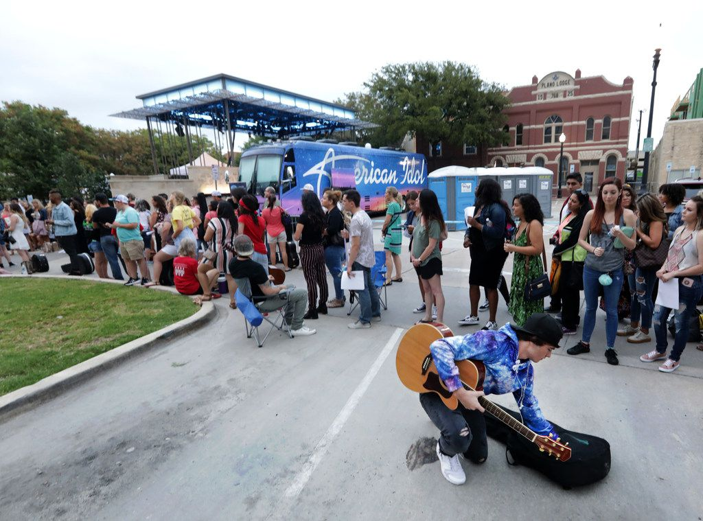"""Spencer Williamson, 16, pulls out his guitar as contestants line up for a chance to sing for producers of """"American Idol"""" at McCall Plaza in Plano, on Sep. 3, 2018."""