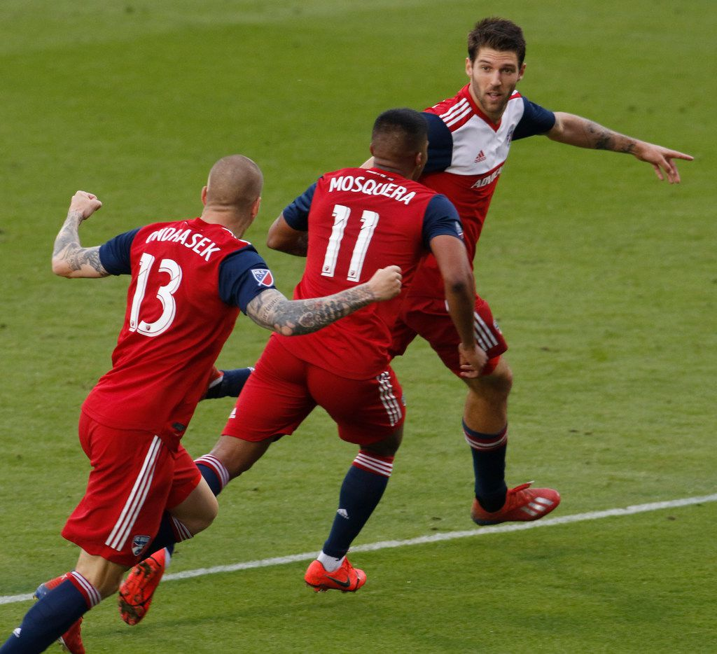FC Dallas' Ryan Hollingshead (12) appears to point to a point of celebration gathering to teammates Santiago Mosquera (11) and Zdenek Ondrasek (13) after his game winning goal during second half action against Colorado Rapids. The goal gave FC Dallas a 2-1 victory. The two teams played their Major League Soccer game at Toyota Stadium in Frisco on March 23, 2019. (Steve Hamm/ Special Contributor)