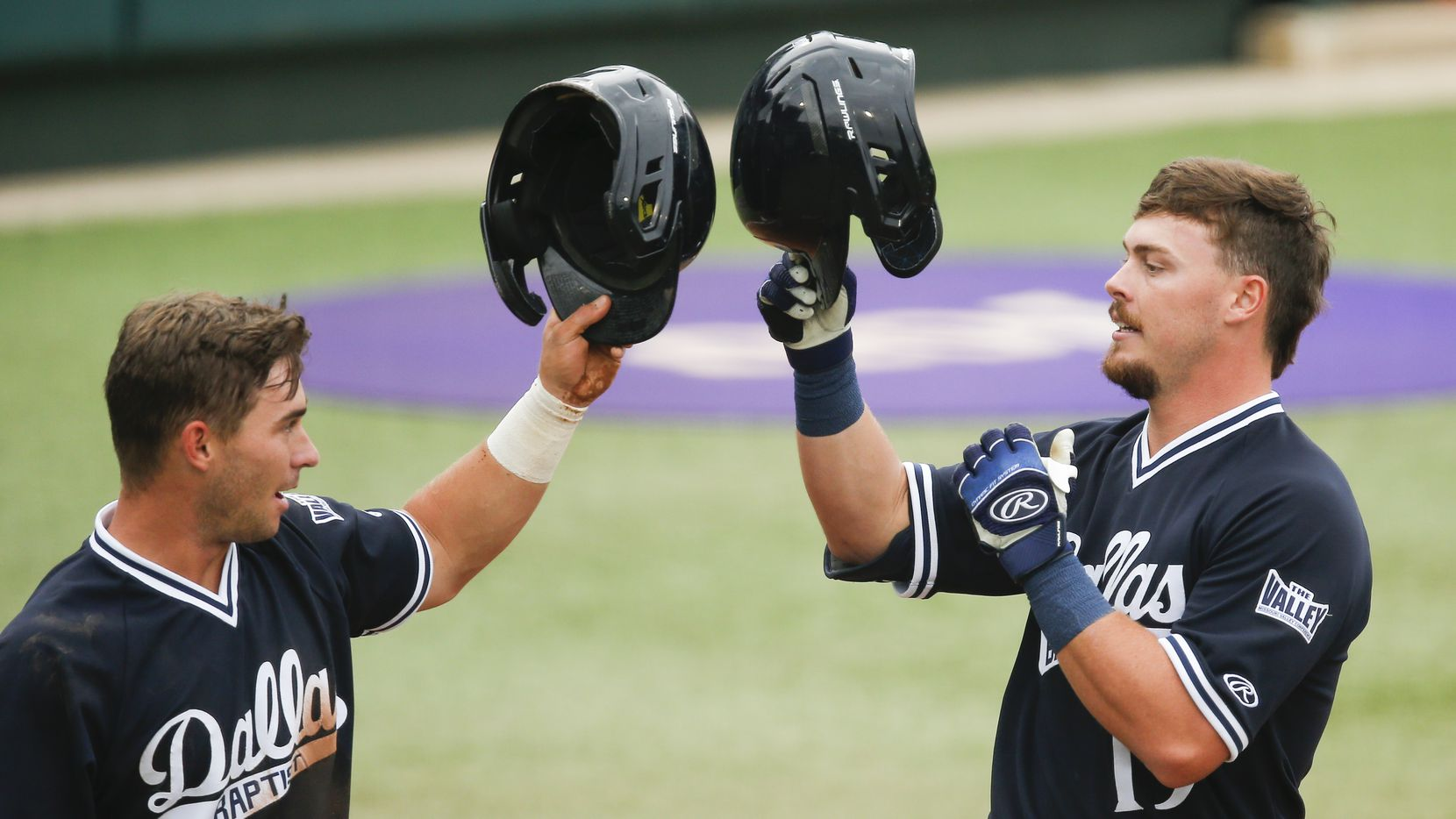 DBU's Cole Moore, right, is congratulated by Jackson Glenn (3) after hitting a two-run home run in the first inning during the NCAA Fort Worth Regional baseball tournament against Oregon State at TCU's Lupton Stadium in Fort Worth, Friday, June 4, 2021. Dallas Baptist won 6-5. (Brandon Wade/Special Contributor)