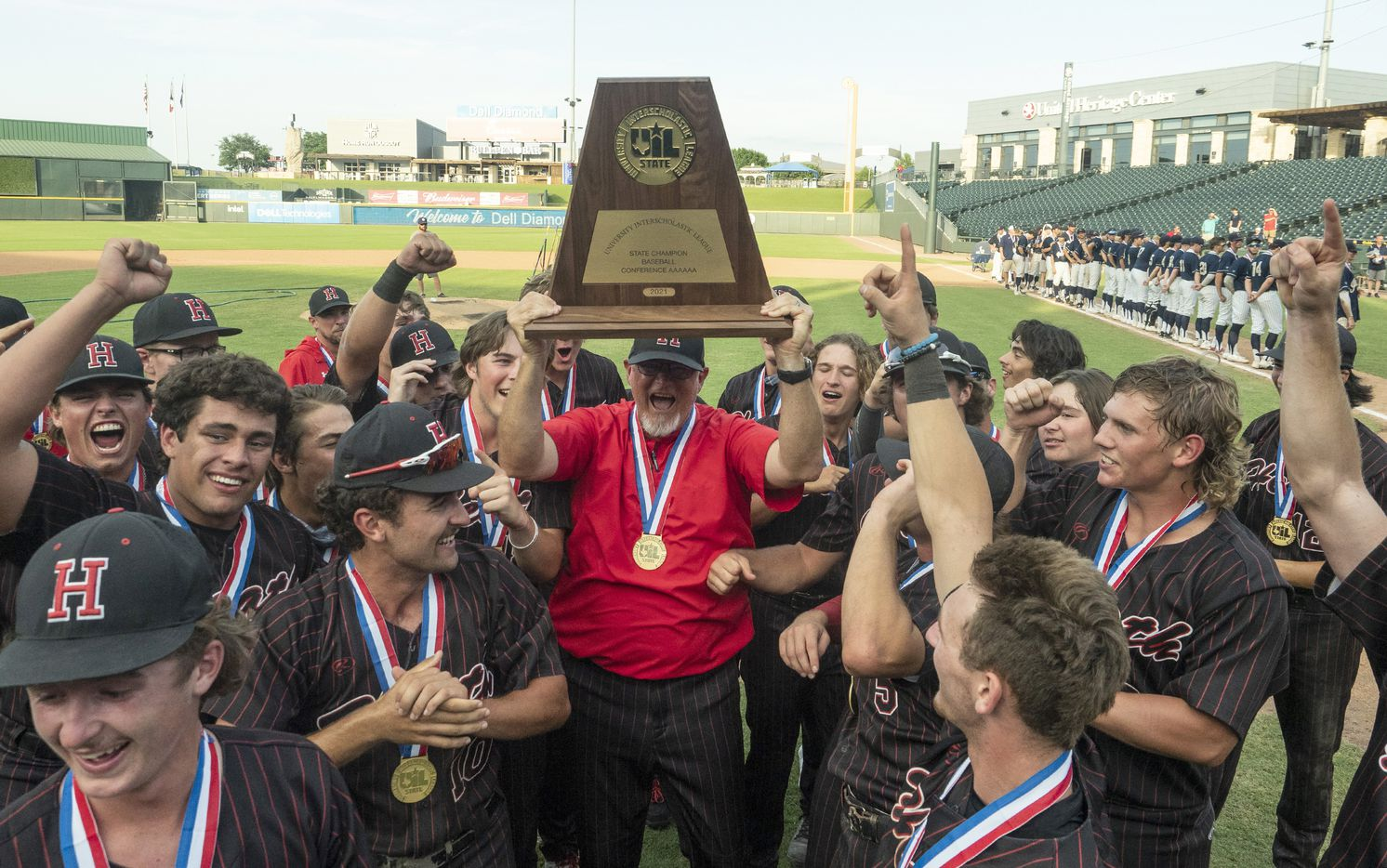 Rockwall-Heath head coach, Greg Harvey and the team celebrate with the championship trophy after defeating Keller in the 2021 UIL 6A state baseball final held, Saturday, June 12, 2021, in Round Rock, Texas.  Rockwall-Heath defeated Keller 4-3.   (Rodolfo Gonzalez/Special Contributor)