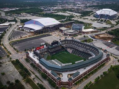 Aerial view of Globe Life Field (top left), AT&T Stadium (top right) and Globe Life Park (bottom) on Thursday, April 9, 2020, in Arlington.