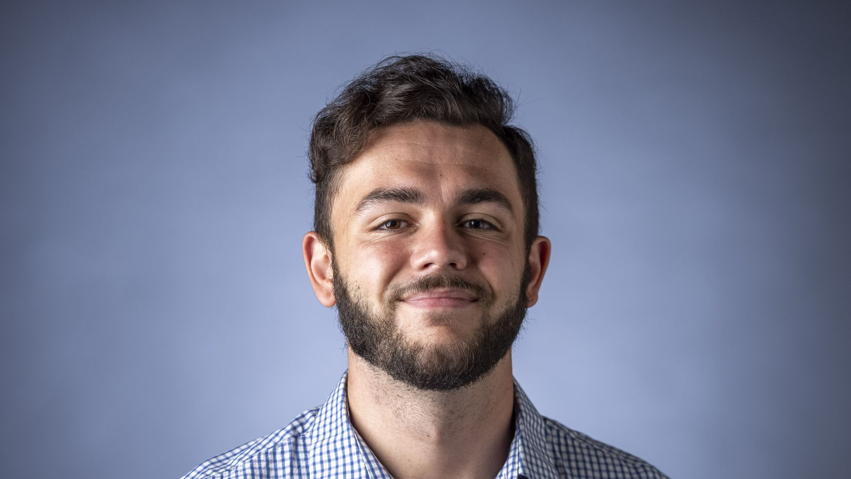 High school sports reporter Shawn McFarland poses for a portrait at The Dallas Morning News studio on Monday, Oct. 4, 2021, in Dallas.