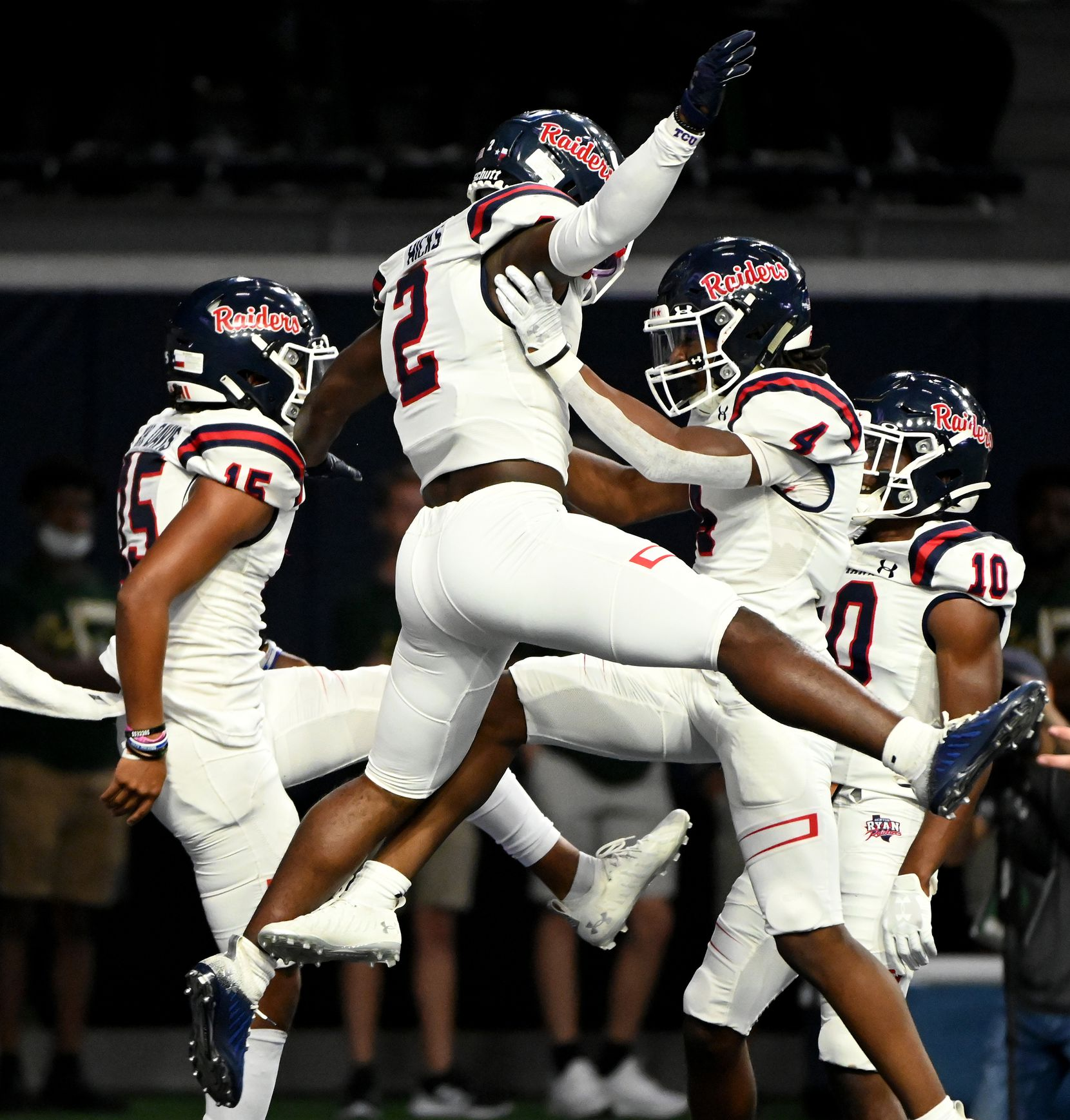 Denton Ryan's Kalib Hicks (2) celebrates his rushing touchdown with Khalon Davis (15) nd Jordyn Bailey in the first half during a high school football game between Longview and Denton Ryan, Saturday, Aug. 28, 2021, in Frisco, Texas. (Matt Strasen/Special Contributor)