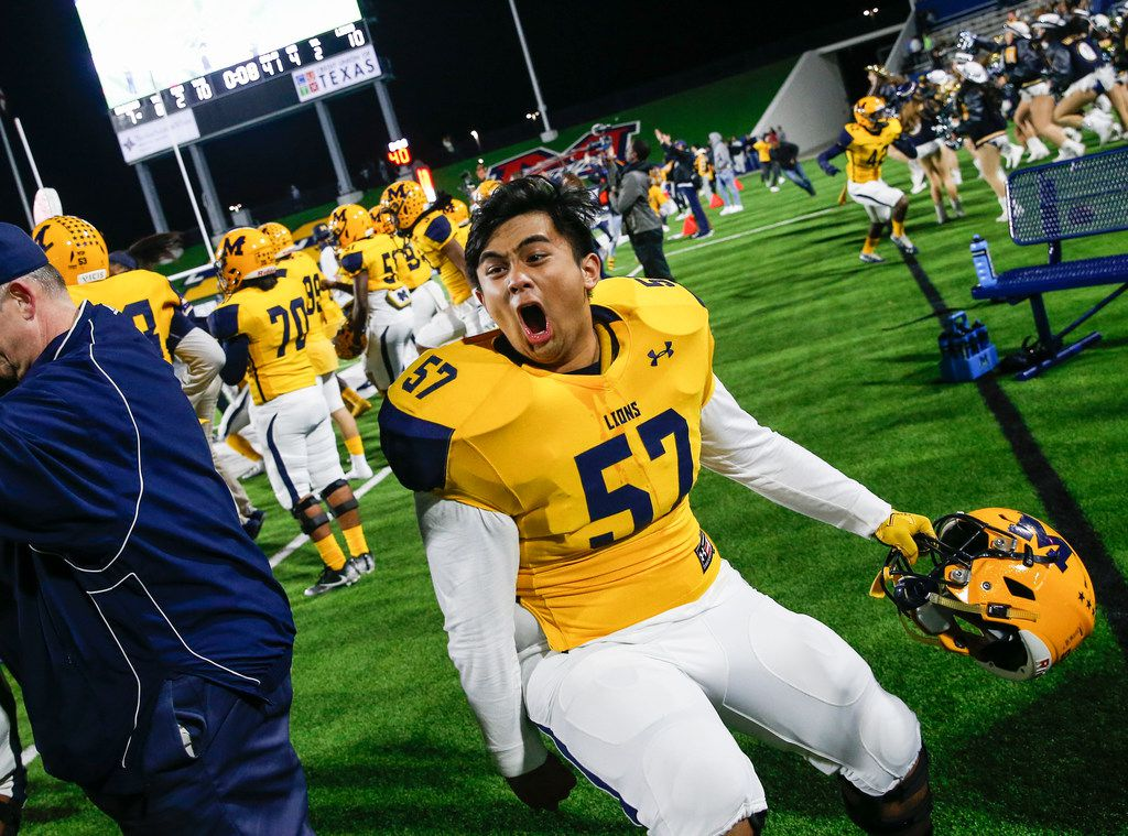 McKinney's Matt Camaligan (57) celebrates in the final moments of their win over McKinney Boyd during a high school football matchup at McKinney ISD Stadium on Friday, Nov. 8, 2019 in McKinney, Texas. (Ryan Michalesko/The Dallas Morning News)