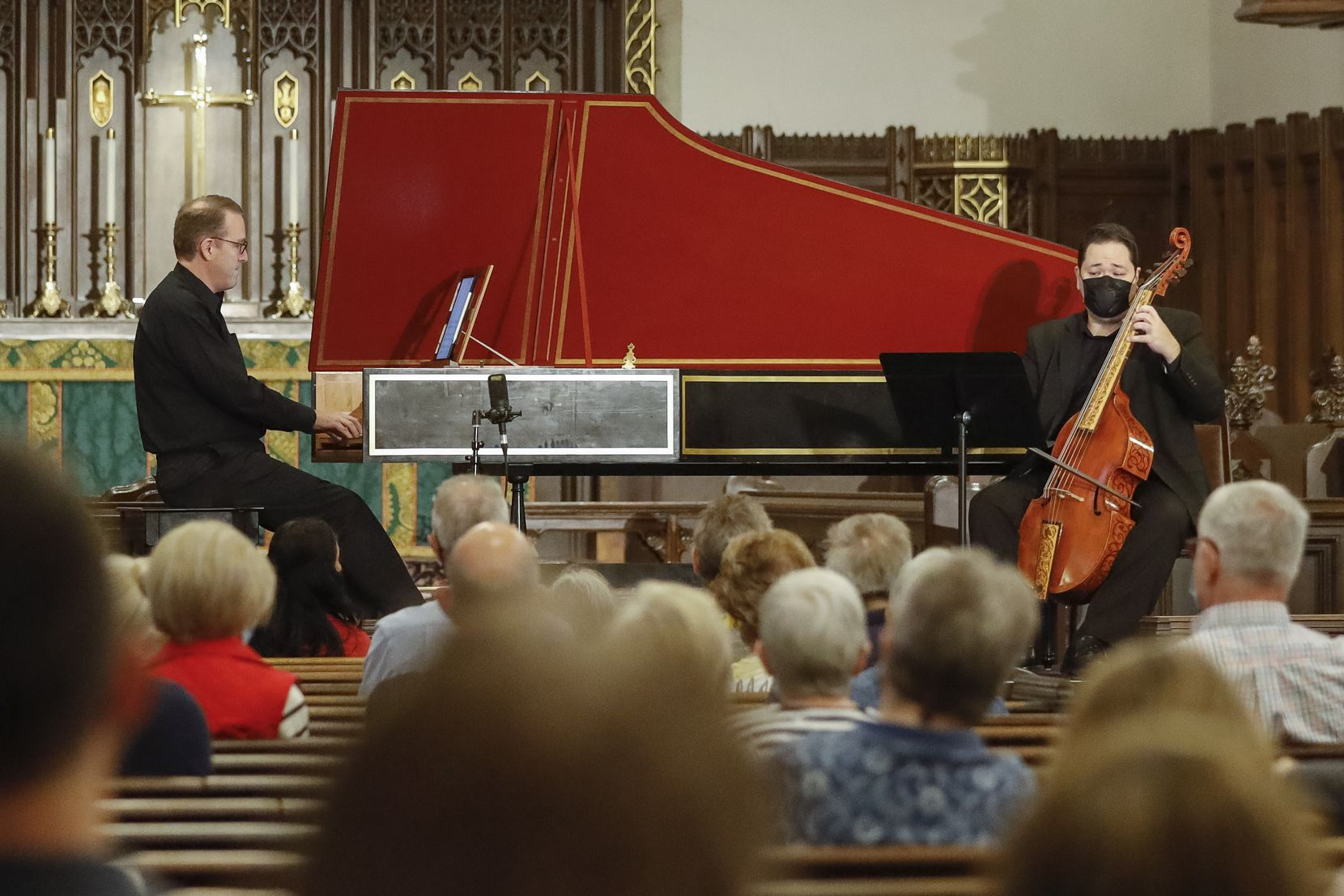 Scott Dettra (left) plays the harpsichord while Eric Smith plays the viola da gamba during the Bach's Lunch concert at Church of the Incarnation on Sept. 14, 2021, in Dallas.