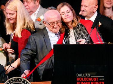 Museum CEO Mary Pat Higgins hugs Holocaust survivor Max Glauben on Tuesday after cutting a red ribbon for the new Dallas Holocaust and Human Rights Museum in downtown Dallas