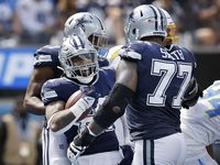 Dallas Cowboys running back Ezekiel Elliott (21) celebrates his first quarter touchdown run with offensive tackle Tyron Smith (77) as they faced the Los Angeles Chargers at SoFi Stadium in Inglewood, California, Sunday, September 19, 2021. (Tom Fox/The Dallas Morning News)