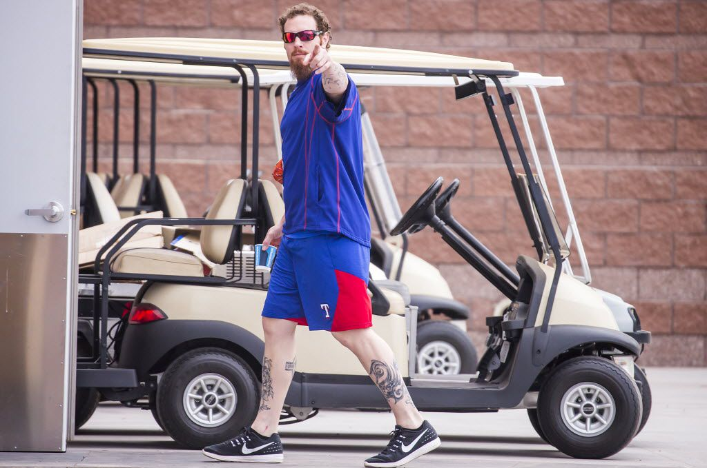 Texas Rangers outfielder Josh Hamilton points to photographers as he walks into the clubhouse on the morning pitchers and catchers reported for spring training at the team's training facility on Thursday, Feb. 18, 2016, in Surprise, Ariz. (Smiley N. Pool/The Dallas Morning News)