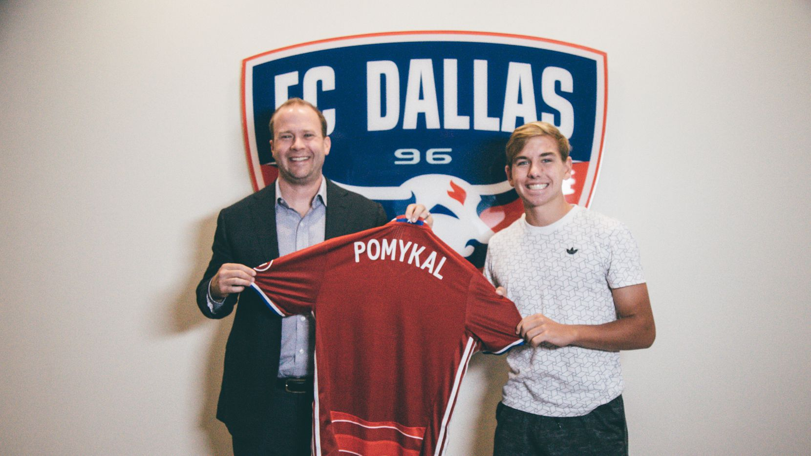 FC Dallas president Dan Hunt, left, is pictured with newest signing Paxton Pomykal, the MLS-record 15th homegrown signing by FC Dallas. Pomykal signed on Thursday, Sept. 8, 2016.
